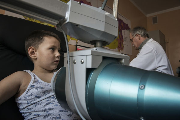 Igor at the Ivankiv hospital while being analyzed with a spectrophotometer to assess internal contamination