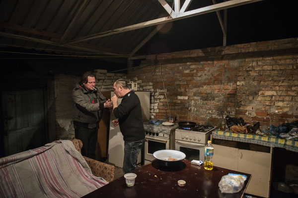 Chernobyl town, Yuriy and Valeri meet up sometimes at Valeri's house to spend the evening together.