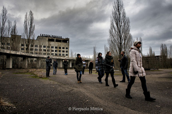 Tourists with their guide in the main square of Pripyat, exclusion zone