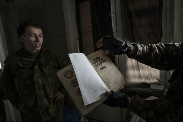 Maxim reading an old book from the Soviet era. Many stalkers come to Pripyat to read old books and magazines abandoned in apartments and schools