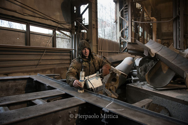 Yuriy while checking the contamination level of the scrap metal after the sandblasting