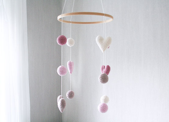 crocheted baby mobile with heart and ball