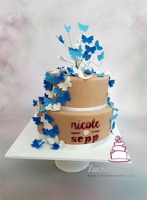 Schmetterlings - Torte, passend zur Einladungskarte, zur Hochzeit von Nicole und Sepp