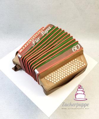 Das eigene Schwyzerörgeli aus Torte zum 60. Geburtstag von Ewald