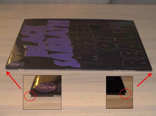 ... ist an den Ecken links und rechts das Laminat abgestoßen! Daher ist da Cover mit NM  zu bewerten!