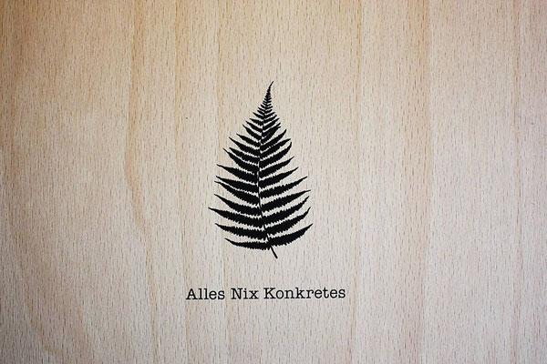 Logo auf dem Frontdeckel der Holzkiste