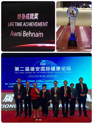 TOP: Lifetime Achievement Award presented to Dr. Awni Behnam, Honorary President of IOI. BOTTOM: L - R: P Leder, Mao B, A Vassallo, Qin L, Lu H, C Virapat, P Virapat, C Chivu. Photo Credits: IOI HQ