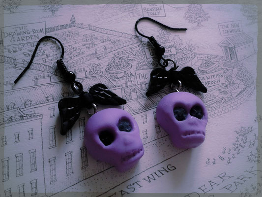 Purple Skull Earrings with Black Wings