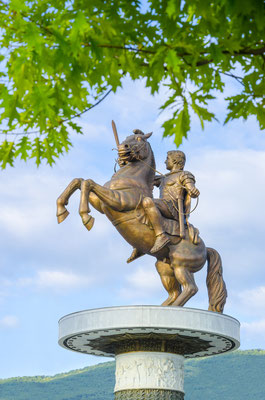 Amazing view of Statue of Alexander the Great through the tree branches in downtown of Skopje, Macedonia, portrait Copyright zefart