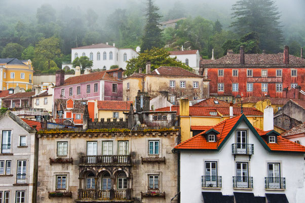 View facades of houses of the city of Sintra in a foggy day - Copyright sssanchez