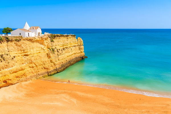 White small church on top of cliff at Armacao de Pera beach, Algarve region, Portugal Copyright Pawel Kazmierczak