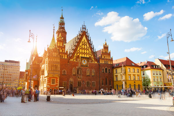 Colorful morning scene on Wroclaw Market Square with Town Hall. Sunny cityscape in historical capital of Silesia, Poland, Europe. Copyright Andrew Mayovskyy
