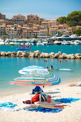 Colorful umbrellas on Puerto de Soller, Port of Mallorca island in balearic islands, Spain by Romas_Photo