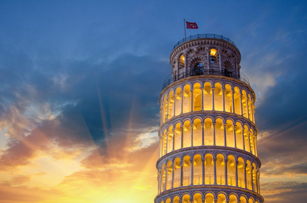Tower of Pisa illuminated at Night with sunset, Italy - Copyright pisaphotography