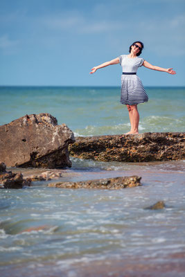 Young beautiful woman on beach vacation in Liepaja Copyright  Levranii