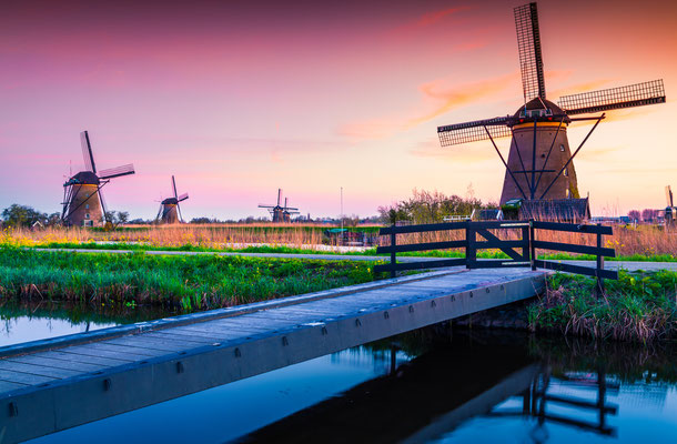 Sunset in Dutch village Kinderdijk near the Hague, Netherlands by Andrew Mayovskyy