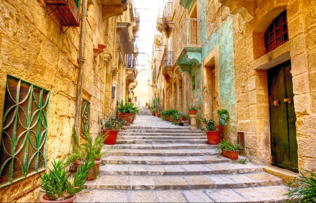 typical narrow street with stairs in the city Valetta on the island of Malta Copyright Chantal de Bruijne