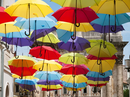 Multicolored umbrellas in the main street of Pula, Croatia - Copyright burnel1