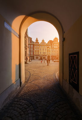 View from under the arch on market square during sunset, in Wroclaw, Poland Copyright Velishchuk Yevhen