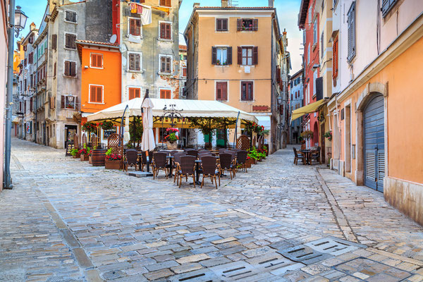 Spectacular stone paved street with colorful houses and typical street cafe bar, Rovinj old town,Istria region,Croatia,Europe - Copyright Gaspar Janos