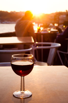 Glass of red Porto wine in a bar in Ribeira, Porto, Portugal - Copyright by pcruciatti