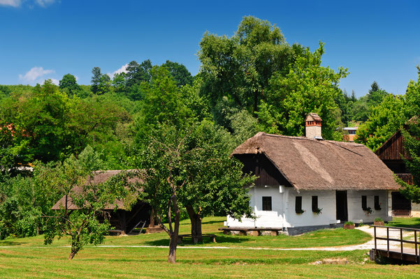 Idyllic village scene in Croatian countryside. Kumrovec historical village, Zagorje area of Croatia - Copyright Evgeniya Moroz