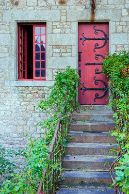 Red medieval door in Mont Saint Michel abbey in France -Copyright Max Topchii