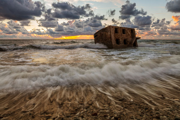 Stunning seascape with part of the old demolished forts in background in Liepaja, Latvia on the Baltic sea coast while sunset after storm Copyright Konstantin Romanov