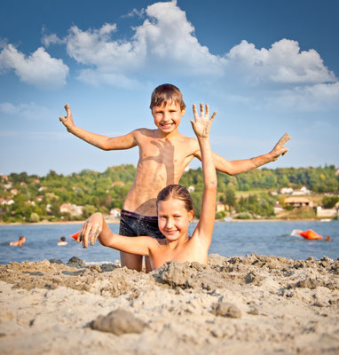 Boy and Girl on the public beach Strand at Danube river in Novi Sad, Serbia. Copyright Aleksandar Todorovic