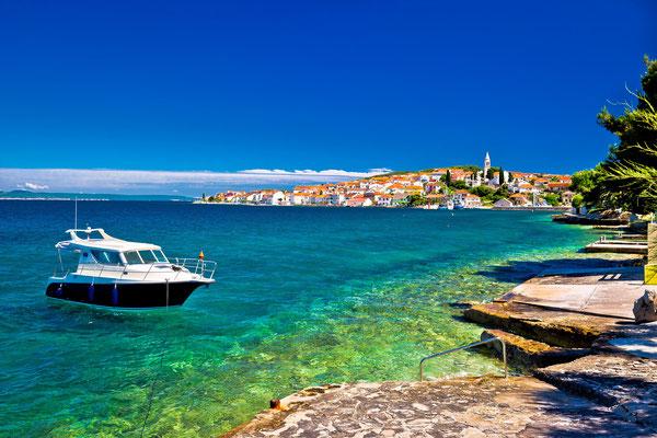 Kali beach and boat on turquoise sea, Island of Ugljan, Croatia - Copyright xbrchx