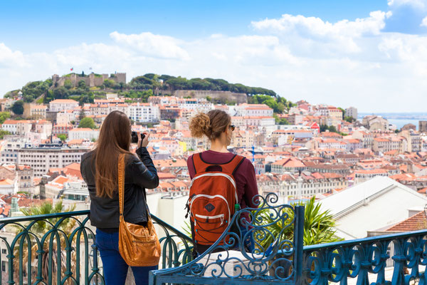 Tourist watching to Lisbon rooftop from Sao Pedro de Alcantara viewpoint - Miradouro in Portugal Copyright Samuel Borges Photography