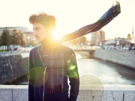 Young man on Sarajevo sunset feeling wind in his scarf as double exposure lens flare Copyright Zurijeta