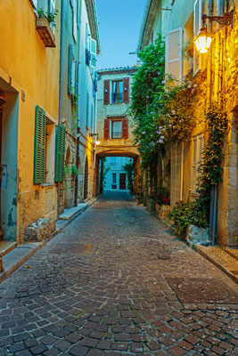 Narrow street in the old town Antibes in France by Laborant