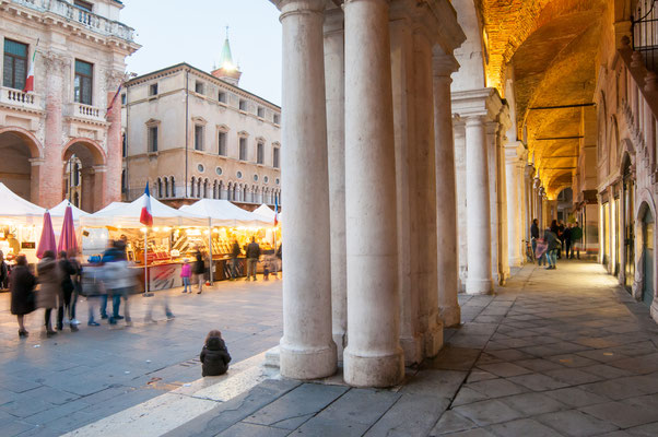 View of the columns and arches of the Palladian Basilica in Vicenza at dusk Copyright Marco Ossino