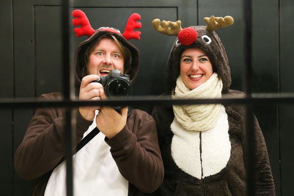 Young couple dressed up as two reindeer at Christmas in Madrid taking a selfie in an hotel mirror Copyright Semmick Photo