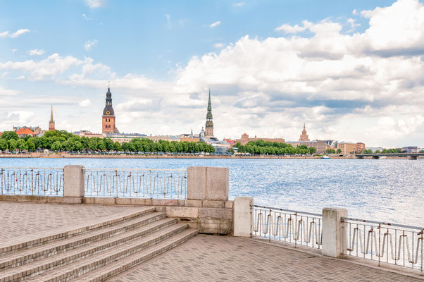 Rigas Cathedral and Saint Peters Church view across the Daugava river, Latvia Copyright elesi