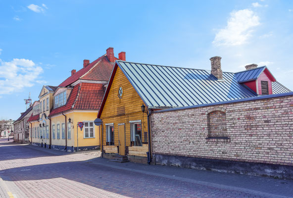 Wooden houses in Ventspils of Latvia by Roman Babakin