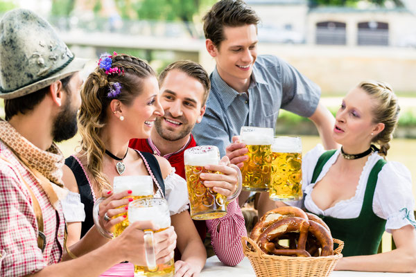 Friends in Bavarian beer garden drinking in summer Copyright Kzenon