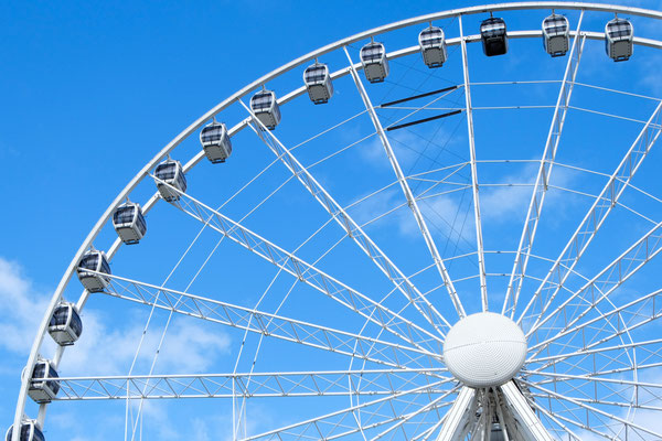 A big Ferris wheel in Manchester UK with blue sky Copyright Doubleo44