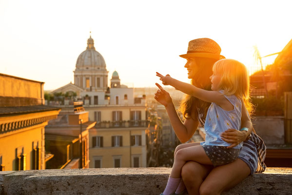 People overlooking rooftops of Rome at sunset - Copyright Alliance