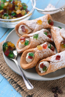 Sicilian cannoli with candied fruit - Traditional Italian dessert Copyright al1962