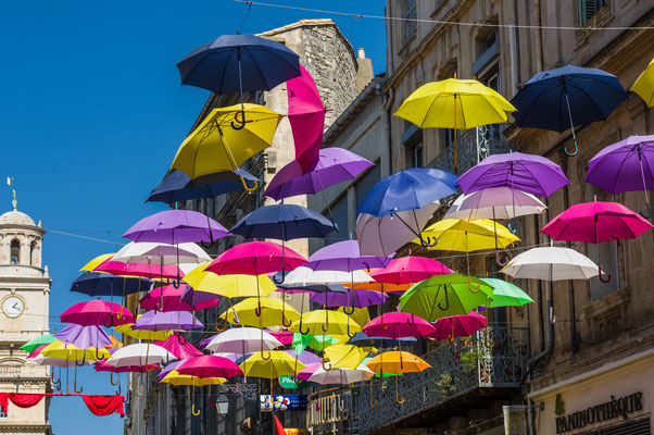 Street of Arles decorated with colored umbrellas, Provence. France - Emanuele Mazzoni Photo