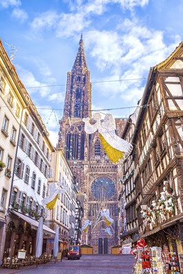 Festive Christmas decorations on streets in medieval city of Strasbourg, France - By MarinaDa