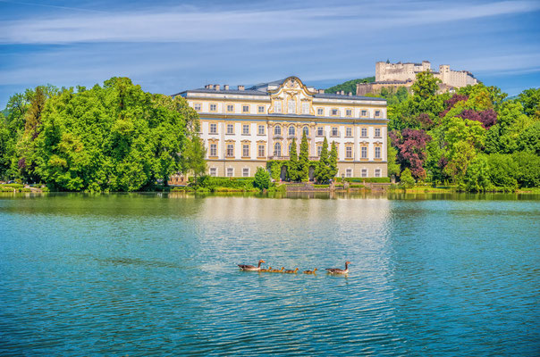 Famous Schloss Leopoldskron with Hohensalzburg Fortress in the background on a sunny day with blue sky in Salzburg, Austria Copyright canadastock