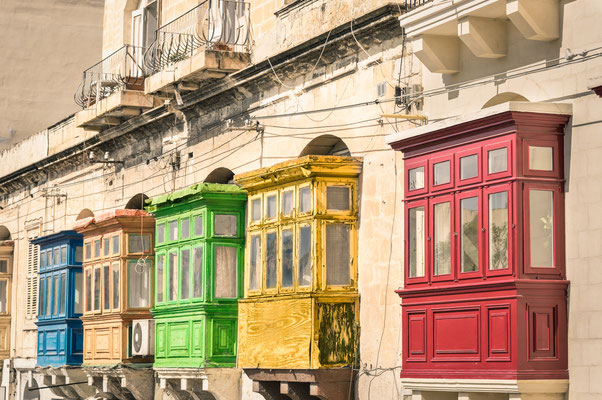 Vintage view of typical buildings balconies in La Valletta - Colorful travel in Malta on the road - Popped up filtered version CopyrightView Apart