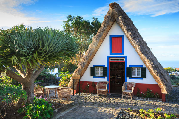 Typical old houses on Santana, Madeira island, Portugal Copyright Lukasz Janyst
