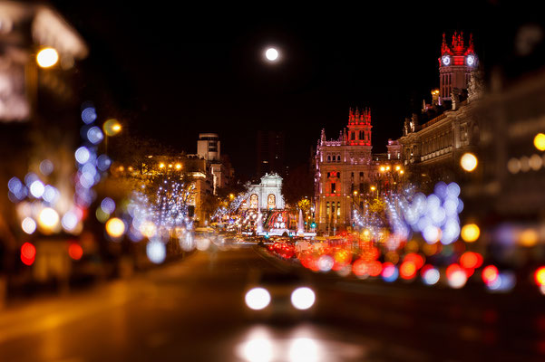 Madrid at Christmas. Rays of traffic lights on Cibeles square, Cibeles fountain in front of the The City Hall or the former Palace of Communications in Madrid, Spain. Copyright Nacroba