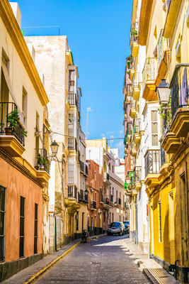 A narrow street in historical center of Cadiz, Spain by Pavel Dudek