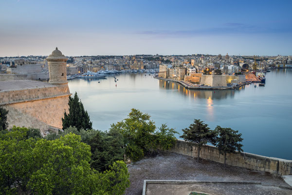 Valletta, Malta - Early morning skyline view of the Grand Harbour of Malta with watch tower and Senglea at the background Copyright Zoltan Gabor