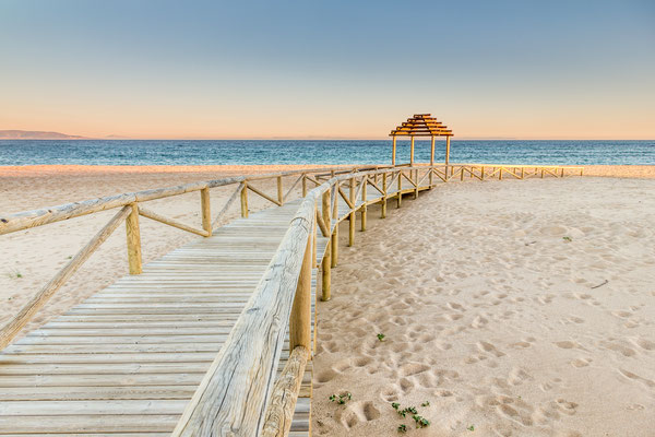 Wooden boardwalk to the beach. Idyllic scene in Trafalgar coast, Cadiz, Spain. Copyright ajcabeza